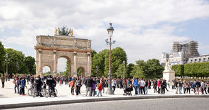 Place Carrousel, Louvre. Tourists walk and take pictures Royalty Free Stock Photography