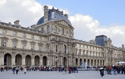 Place Carrousel, Louvre. Tourists walk and take pictures Stock Photo