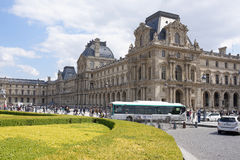 Place Carrousel, Louvre. Tourists walk and take pictures. Trans Stock Photo