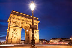 Place Charles de Gaulle, Arc de Triomphe, Paris, France. Place Charles de Gaulle, Arc de Triomphe in Paris, France, at twilight with traffic light trails Royalty Free Stock Images