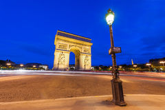 Place Charles de Gaulle at night with illuminated Arc de Triomph. E, Paris, France Stock Images