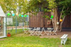 Place for children birthday party front or back green yellow autumn house yard