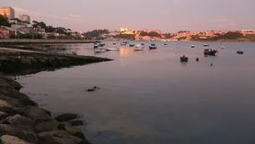 Place of confluence of the Douro river in the Atlantic ocean during sunset.  Portugal. stock video
