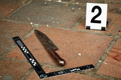 Place of crime - knife. Crime scene investigation - collecting of blood stains Royalty Free Stock Photo