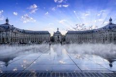Place de la Bourse. Bordeaux, France; 09 04 2014: Place de la Bourse in Bordeaux, people enjoying in the mist of the mirror of water France Royalty Free Stock Photo