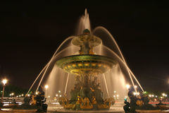 Place de la Concorde fountain in Paris, France. Night photograph of the Fontaine des Mers (Fountain of the Seas, nineteenth century), one of the two monumental Stock Photos