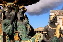 Place de la Concorde neptune Fountain close up Paris France. Detail of the Neptune Neoclassical Fountains with Golden Statues dedicated to River Commerce and stock images