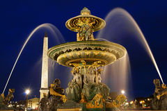 Place de la Concorde by night in Paris, France. The rivers fountain (Fontaine des Fleuves) in Place de la Concorde by night in Paris, France. Selective focus Royalty Free Stock Photo