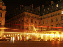 Place De Pyramids - Traffic passing Joan of Arc in Paris. Traffic passes by at night by the Jardin Tuileries in the French capital Stock Photography