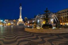 Place de Rossio par nuit Photo stock