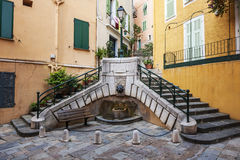 Place du Conseil in Villefranche-sur-Mer. Small square with fountain Place du Conseil used to be the center of local government in medieval town Villefranche-sur Stock Image