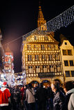 Place du Marche aux Cochons de Lait during Christmas MArket. STRASBOURG, FRANCE - NOV 28, 2015: Busy Christmas Market Christkindlmarkt in the city of Strasbourg Royalty Free Stock Images
