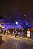 Place du Tertre in Montmartre alla notte Immagine Stock
