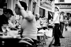 Place Du Tertre, Paris, France. THE artist square in Paris. Pefect street scene showing normal people going about their daily business in a Paris Restaurant Stock Images