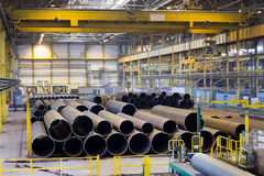 Place for finished products with big pipelines, an industrial plant. Indoor stock images