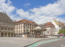 Place Gutenberg in Strasbourg, France. Gutenberg square in Strasbourg, France with old Gutenberg monument and carousel in summer Royalty Free Stock Image
