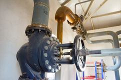Place in a large industrial boiler room. Stock Image