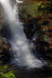 The camera slows a waterfall as it flows in to a rock pool. Stock Photography