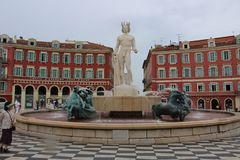 Place Massena. The beautiful fountain of Place Massena in Nice with the Greek god Apollo in the center looking at the sea royalty free stock photography