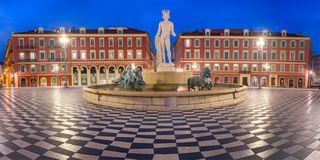 Place Massena in Nice, France. Panoramic view of Beautiful square Place Massena with the Fountain du Soleil at night Nice, French Riviera, Cote d`Azur, France royalty free stock images