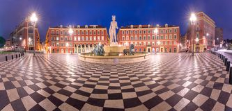 Place Massena in Nice, France. Panoramic view of Beautiful square Place Massena with the Fountain du Soleil at night Nice, French Riviera, Cote d`Azur, France royalty free stock photography