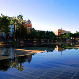 Place Massena is reflected in the pond in Central Park of Nice. Place Massena is reflected in the pond in pond on the promenade area of Nice Royalty Free Stock Photography