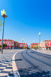 Place Massena with statues on columns in Nice, France. Royalty Free Stock Photography
