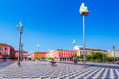 Place Massena with statues on columns in Nice, France. Stock Image