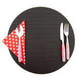 Place mat with red cutlery Stock Photography