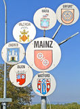Place name sign of Mainz. Germany, with related town twinned cities Valencia, Erfurt, Dijon, Haifa, Zagreb, and Watford Stock Images