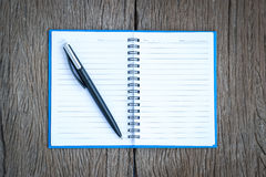Place the pen on a blank page of a notebook. Stock Images
