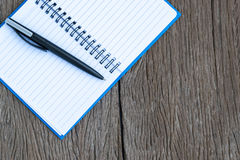 Place the pen on a blank page of a notebook. Stock Photo