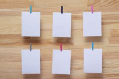 Place for photo cards of moments of life, empty blanks attached to a linen rope with stationery clips on a colored background, a royalty free stock image