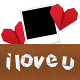 Place the photo of your loved. /Composition for Valentine's day with photograph, two origami hearts and origami text I love you Royalty Free Stock Image