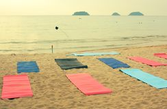 Place prepared for beach yoga lesson on sunset seaside photo. With ocean on the background royalty free stock photography