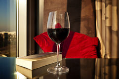 Place for reading - book and wine Stock Photos