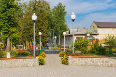 Place for recreation in central square of the Kotelva town waiting for visitors Stock Photo