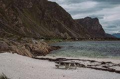 Place for recreation on white sand beach. On Lofoten Islands, Norway royalty free stock image