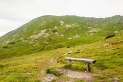 Place of rest. Resting place overlooking the green summit royalty free stock image