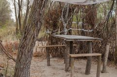 Place for rest with wood table and chairs. For picnic in the forest at river Stock Images