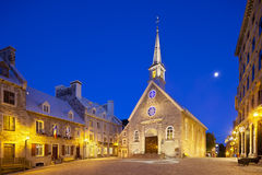 Place Royale in Quebec City, Canada, editorial. Quebec City - June 20: Notre-Dame-des-Victoires at Place Royale in Quebec City, Canada with its old buildings on Royalty Free Stock Photography