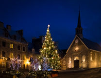 Place Royale Royal Plaza and Notre Dame des Victories Church decorated for Christmas at night - Quebec City, Canada. Place Royale Royal Plaza and Notre Dame des Royalty Free Stock Photos