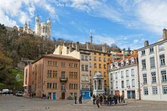 Place Saint-Jean and Fourviere basilica. LYON, FRANCE, March 11, 2018 : Place Saint-Jean and Fourviere basilica, as seen from the entrance of the Cathedral Royalty Free Stock Photos