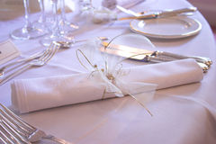 Place setting. Rolled napkin on a banquet table Royalty Free Stock Photos
