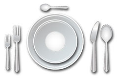 Place setting. Including plates, forks, spoons and knife on a white background Stock Image
