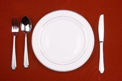 Place setting. Of a dinning set in red background royalty free stock photography