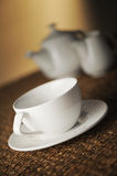 Place setting. Dinner place setting with plates and cutlery shallow dof stock images