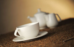 Place setting. Cup of tea, soft focus stock images