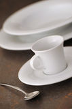 Place setting. Dinner place setting with plates and cutlery shallow dof stock photo