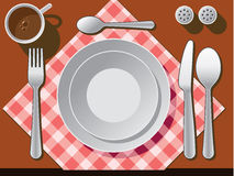 Place setting. With plate, fork, spoon knife, and coffee cup Royalty Free Stock Photography